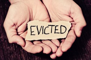 """hands with """"evicted"""" sign"""