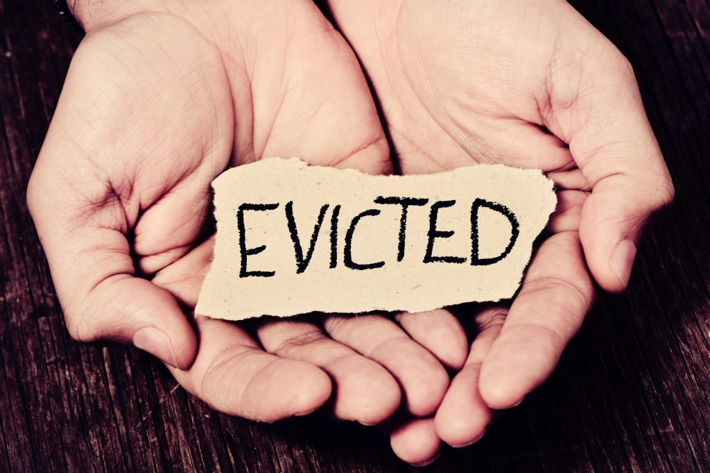 Evicted sign in hands